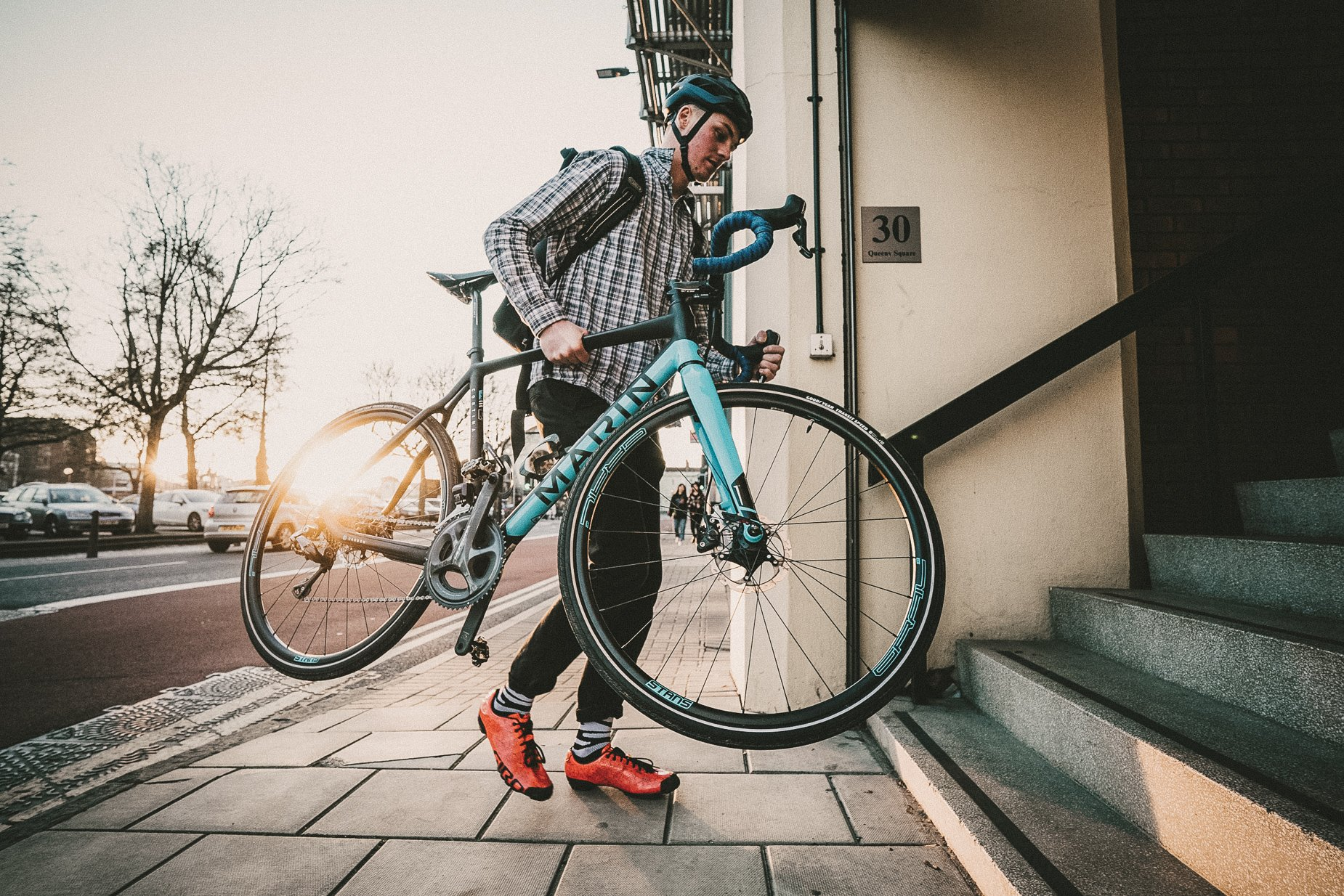 Cyclist commuting of Goodyear tires