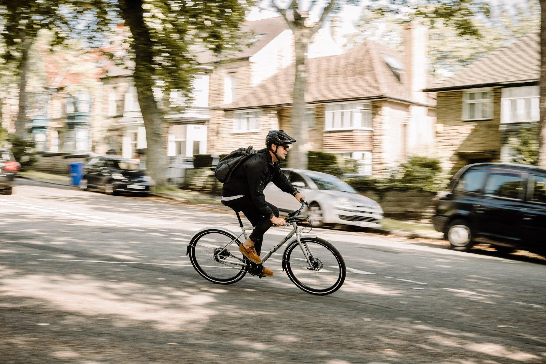 Commutor cyclist riding Goodyear Transit Tour tire