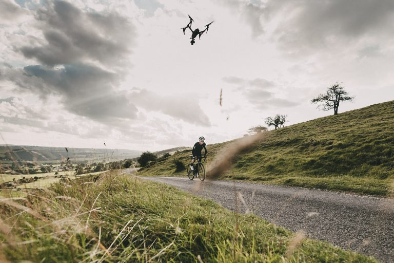Drone flying over cyclist